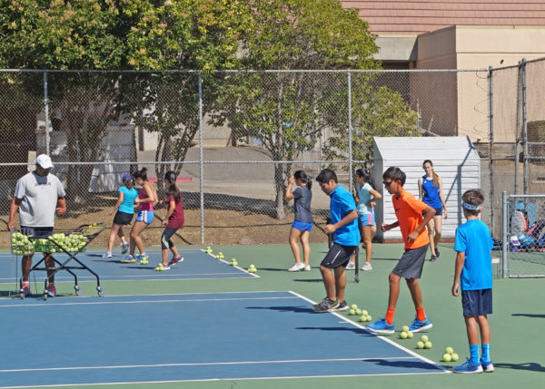 Summer tennis camp participants learn the footwork necessary for long-term success in the sport of tennis. Classes taught by experienced tennis professional Coach Mac cover everything from footwork to strokes and strategy.