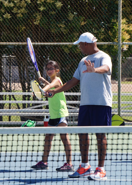 Students participating in Benicia Community Tennis Association's week-long summer camp clinics range in experience from beginners to advanced players. Each is taught according to his or her level. Here a newer player learns basic tennis stroke form.