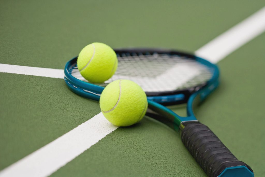 Image of racket and tennis balls.